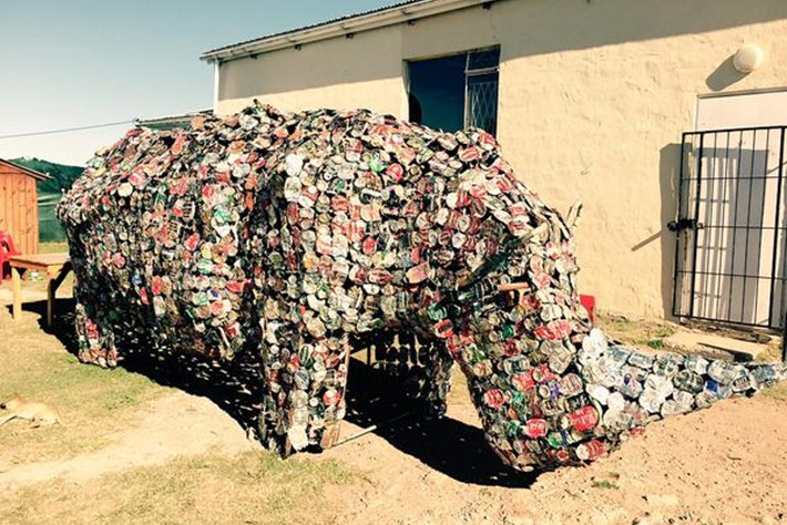 'Waste artist' transforms old cans into a rhino sculpture to teach kids about conservation